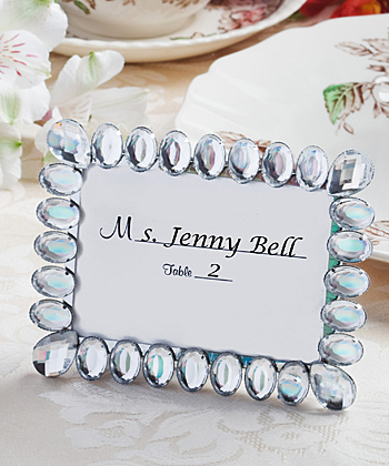 each silver metal frame measures 45 x 325 and features a covering of brilliant clear rhinestones around the front with oval rhinestones and multifaceted